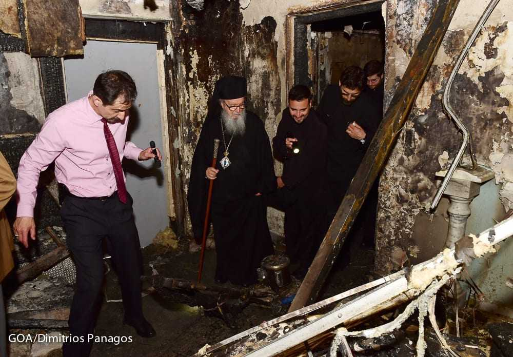 Archbishop Demetrios at the fire-ravaged Greek Orthodox Church of the Transfiguration of Christ in Corona, NY.